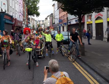 People riding the bike in Cork