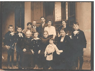 Old sepia family photo from Gheorgheni, Romania