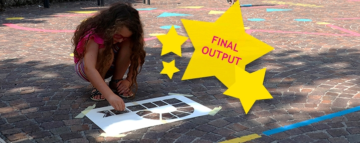 Child drawing the Playful Paradigm logo on a pavement